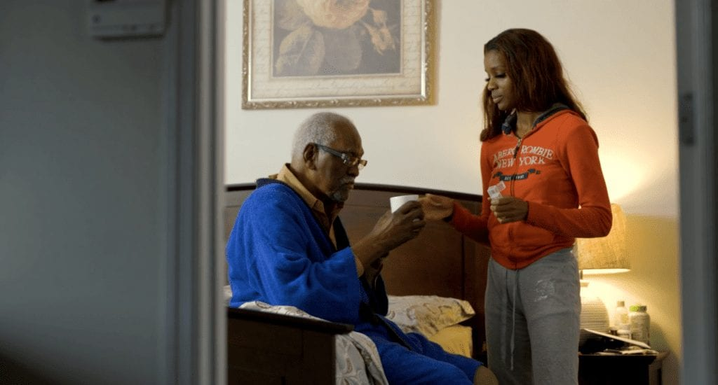 Missouri CDS participant and caregiver delivering personal care